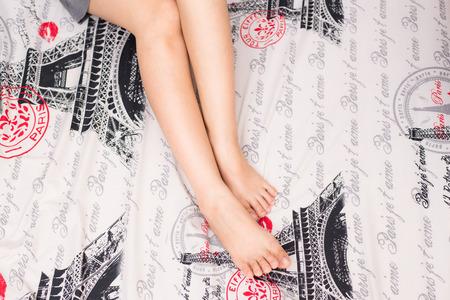 Slim beautiful women leg on comfort bed cozy room