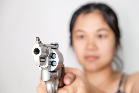 Women shooting target with .357 .44 magnum revolver gun on white background Stock Photo