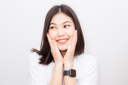 Smiling asian women with smart watch sitting on white background, Communication technology Stockfoto
