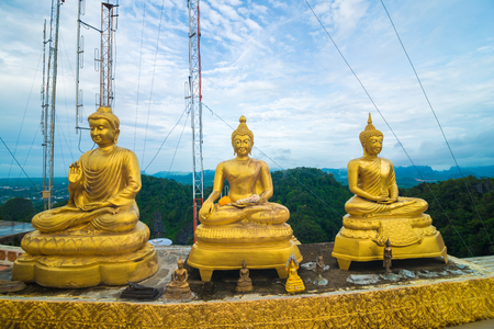 Golden buddha statue locate on peak of mountain in morning Archivio Fotografico