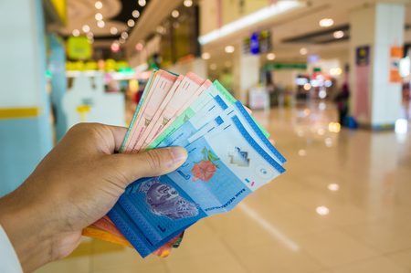 Malaysia money ringgit bill in hand ready for shopping