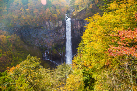 Japanese waterfall in autumn season with colorful tree leaves, Travel in Japan