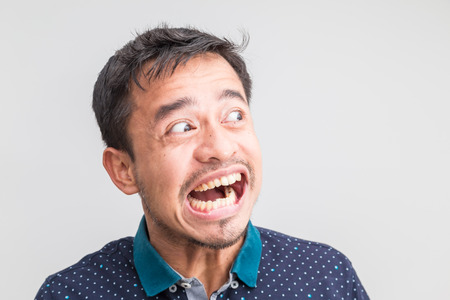 Portrait of angry mood mustache asian man on white background Banque d'images