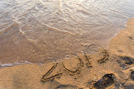 2019 Happy new year on seashore sand beach sunset colorful sky Stock Photo