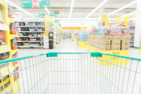 Abstract blurred row of goods in modern trade supermarket business background