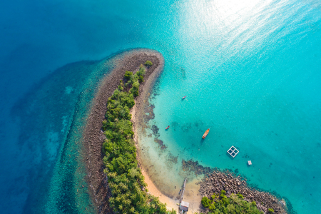 Amazing island with sand beach green tree forest aerial view blue sea water
