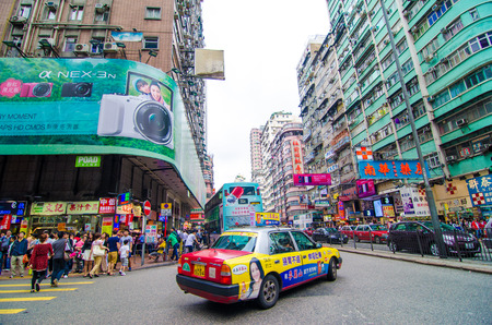Hong Kong, China - April 21, 2013: crowds of unidentified people crossing King's Road in HK Island. HK is one of worlds most significant financial centres and the 4th most densely populated state - Image