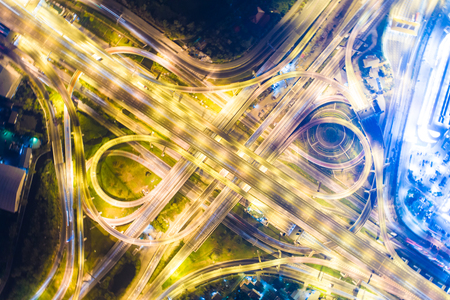 Intersection transport road with vehicle light movement aerial view Banco de Imagens