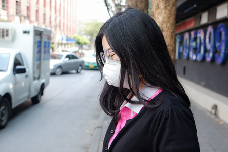 Women wearing protective mask n95 suffering air pollution on street, Air pollution in city Stock Photo