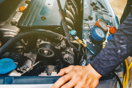 Mechanic check car air conditioner system in garage fix car air problem
