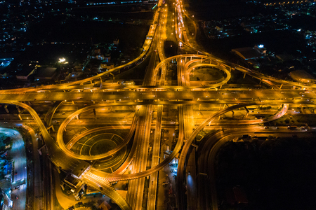 Vehicle light movement rush hour on city traffic junction road aerial view