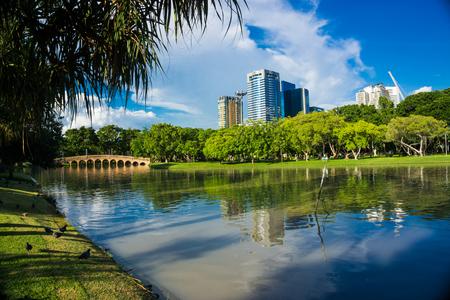 Bridge lake in Chatuchak city public park blue sky with building, City park 스톡 콘텐츠