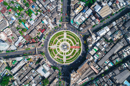 City traffic road with modern building aerial view in Bangkok Thailand