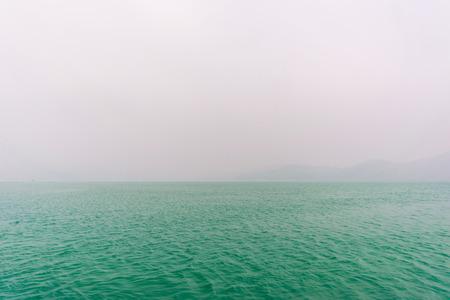 Sun moon lake in morning blue sky with fog, Nantou Taiwan