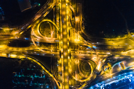 Night traffic city transport road with light of vehicle movement aerial view