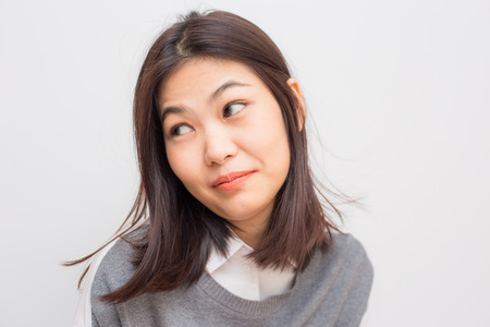 Portrait of happy young beautiful asian women on white background