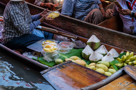 Fruit and local food sell on boat at floating  market, Thailand