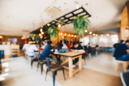 Abstract blurred defocus group of people in coffee shop with light