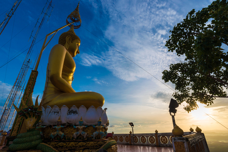 Buddha statue on mountain sunrise light in morning, Krabi Thailand