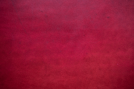 Abstract background of genuine red cartier leather, Tanned leather background 免版税图像