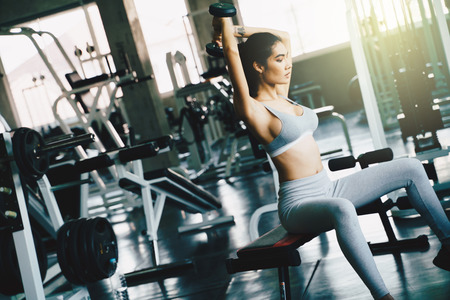 Wellbeing smart asian sport women lifting dumbbell in gym, Healthy lifestyle