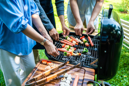 Party group of middle age with bbq grilled and drink in park Banco de Imagens