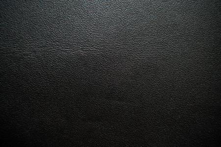 Abstrakter schwarzer echter Vollnarbenlederhintergrund, Kuhhautbeschaffenheit Standard-Bild