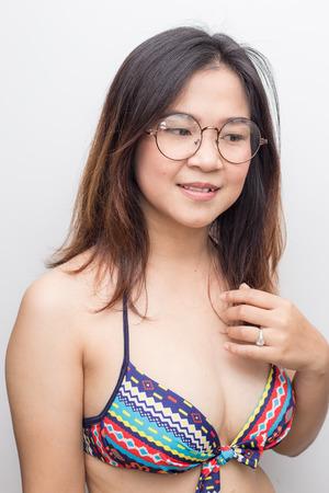 Portrait of beautiful asian bikini women summer vacation on white background
