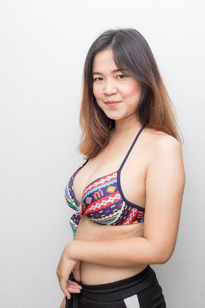Portrait of beautiful asian bikini women summer vacation on white background Stock Photo - 124894299
