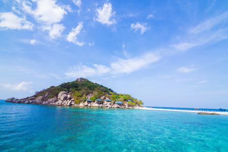 Idyllic sea island with blue sky cloud vacation concept Фото со стока