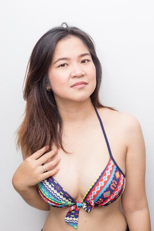 Portrait of beautiful asian bikini women summer vacation on white background 写真素材 - 124894311