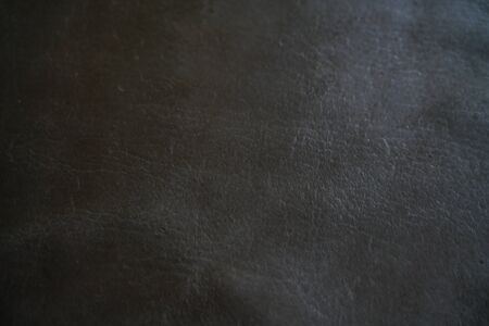 Abstract genuine tanned leather black background, Luxury leather texture