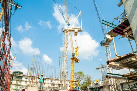 Construction site condominium building with man, Real estate industry