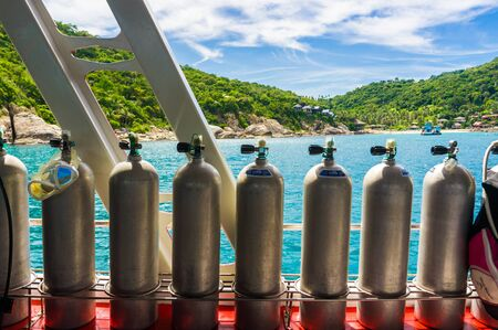 Diving oxygen air tank on boat in sea with equipment