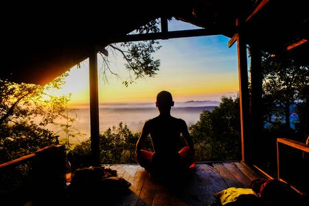 Buddhist monk meditation in tropical forest, Spiritual concept
