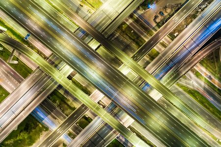 Night traffic junction road with light of vehicle movement aerial view from drone Foto de archivo - 129913496