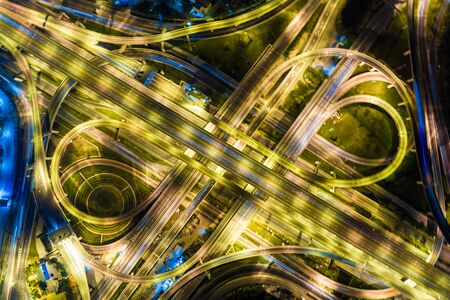 Night traffic junction road with light of vehicle movement aerial view from drone Foto de archivo - 129914936