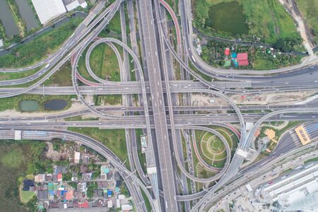 Intersection cross traffic city road with vehicle transport aerial view Foto de archivo - 129915049