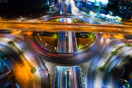 Aerial view night roundabount traffic road with car light movement, Night transport