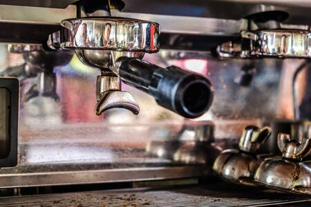 Coffee machine industrial tool preparing crafts coffee and pouring, Food and drink concept