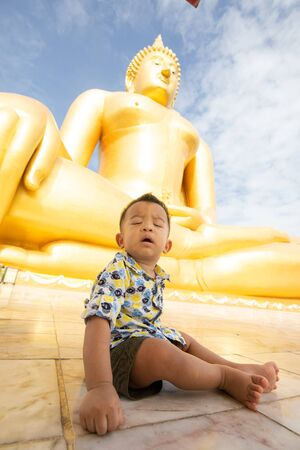 Adorable baby boy travel in buddhism temple recreation of weekend