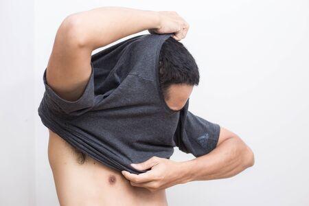 Asian men take off shirt on white background Фото со стока