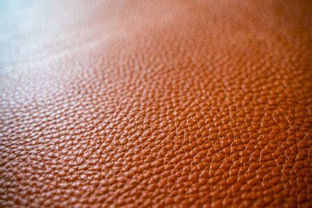 Hellbrauner brauner echter Lederbeschaffenheitskuhhauthintergrund