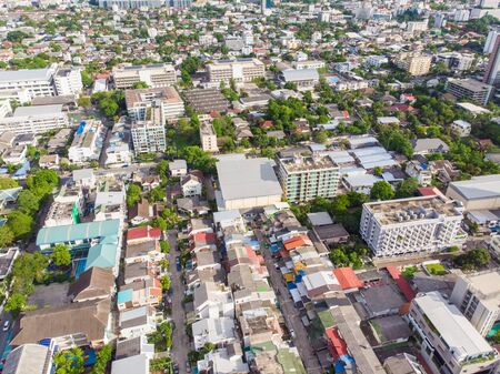 Aerial view Bangkok modern office building and living block sunshine day
