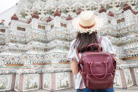 Beautiful asian tourist backpack women travel in buddhist temple sightseeing of Bangkok, Thailand