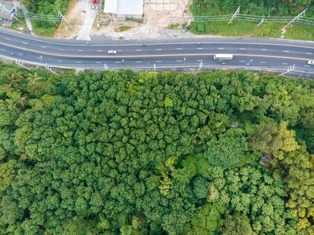 Mountain road tropical forest on island aerial view
