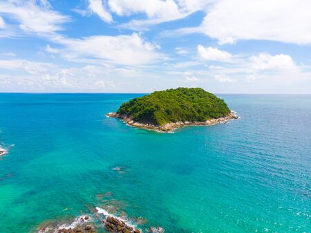 Sea island with turquoise water against blue sky aerial view 写真素材