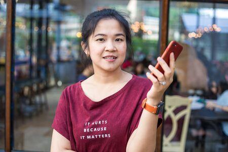 Women using smartphone sitting in modern coffee shop, Communication business