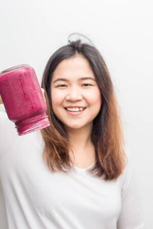 Asian wellnes women with blue berry smoothies summer drink on white background