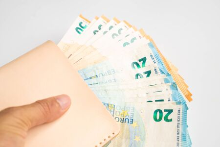 Pile bundle of euro money in business hand on white background, Business finance